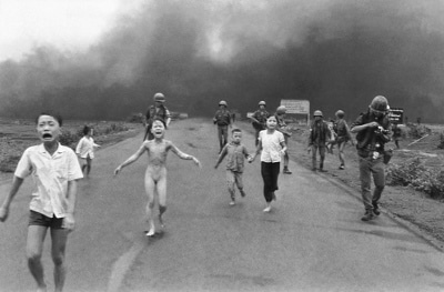 Kim Phúc, center left, running down a road naked near Trang Bang after a South Vietnamese Air Force napalm attac